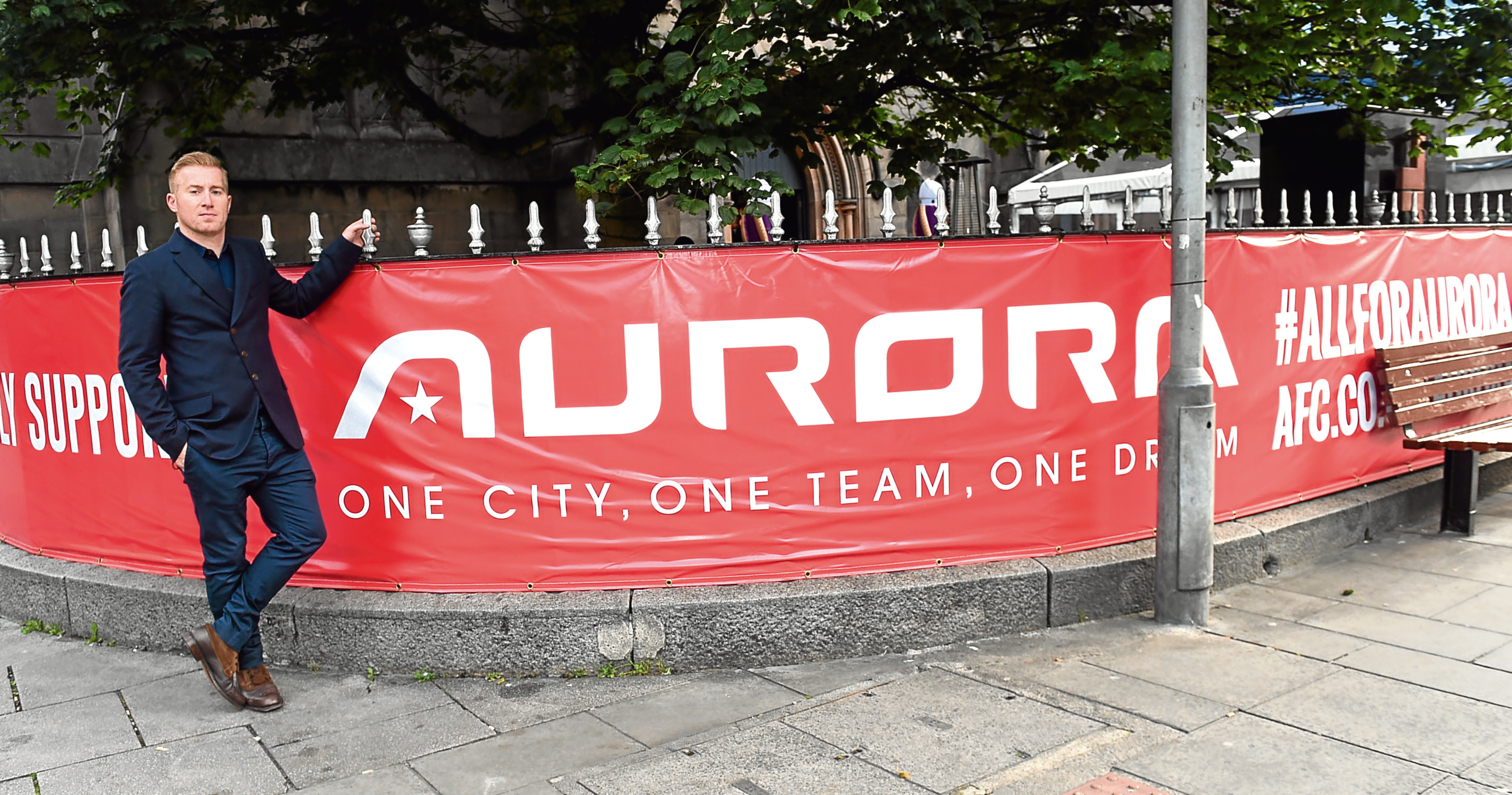 Paul Clarkson with the banner outside Soul
