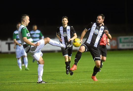 Pictured are Buckie's John McLeod and Fraserburgh's Marc Dickson.