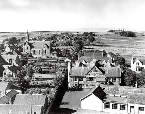 1962: Not an aerial view, but the next best thing. This is how New Deer looks from the top of St Kane's Church, looking across the village, with New Deer School in the foreground and the monument on the Hill of Culsh in the distance.