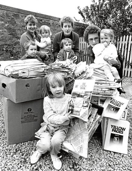 1988: Members of New Deer Mother and Toddlers Group with some of the five tons of paper and cardboard they have collected over the past few months to sell for funds for the group.