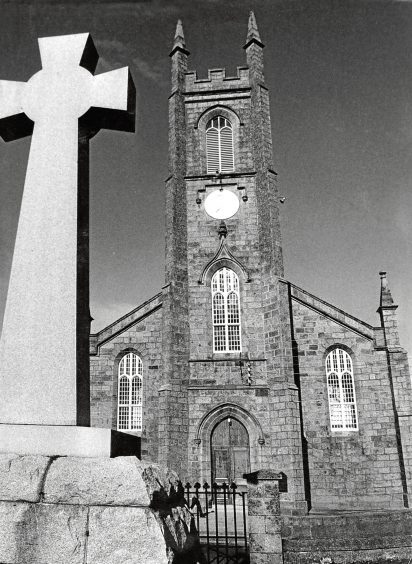 1970: New Deer Parish Church, St Kane's, with the war memorial in the foreground.