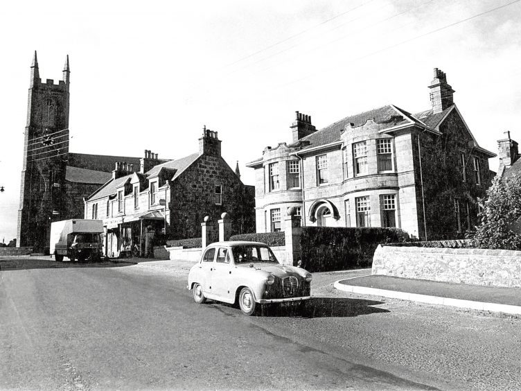 1970: A view from Fordyce Terrace along Church Crescent in New Deer showing St Kane's Church.