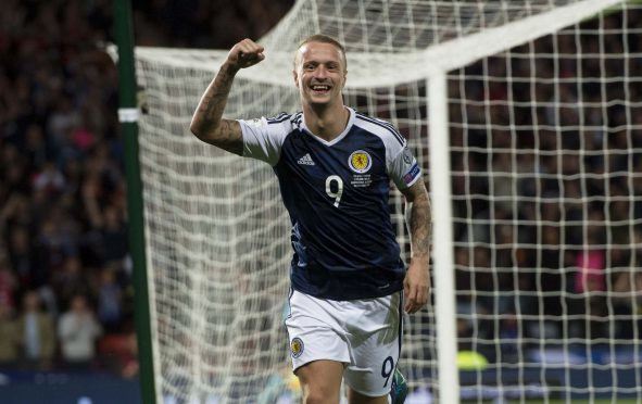 Scotland's Leigh Griffiths celebrates after scoring to make it 2-0.