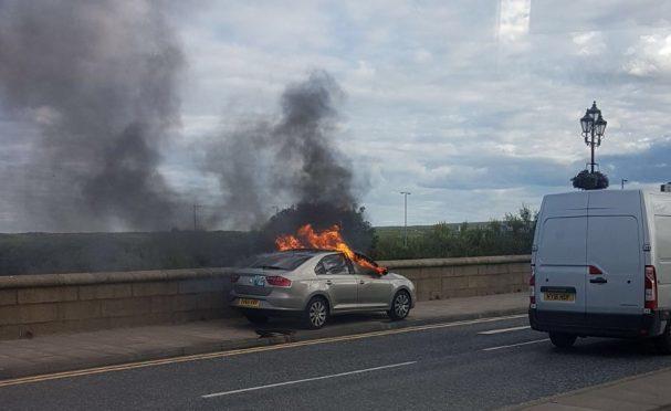 Taxi on fire on the Ellon Road bridge.