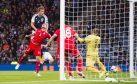 Scotland's Christophe Berra (left) heads home the opening goal.