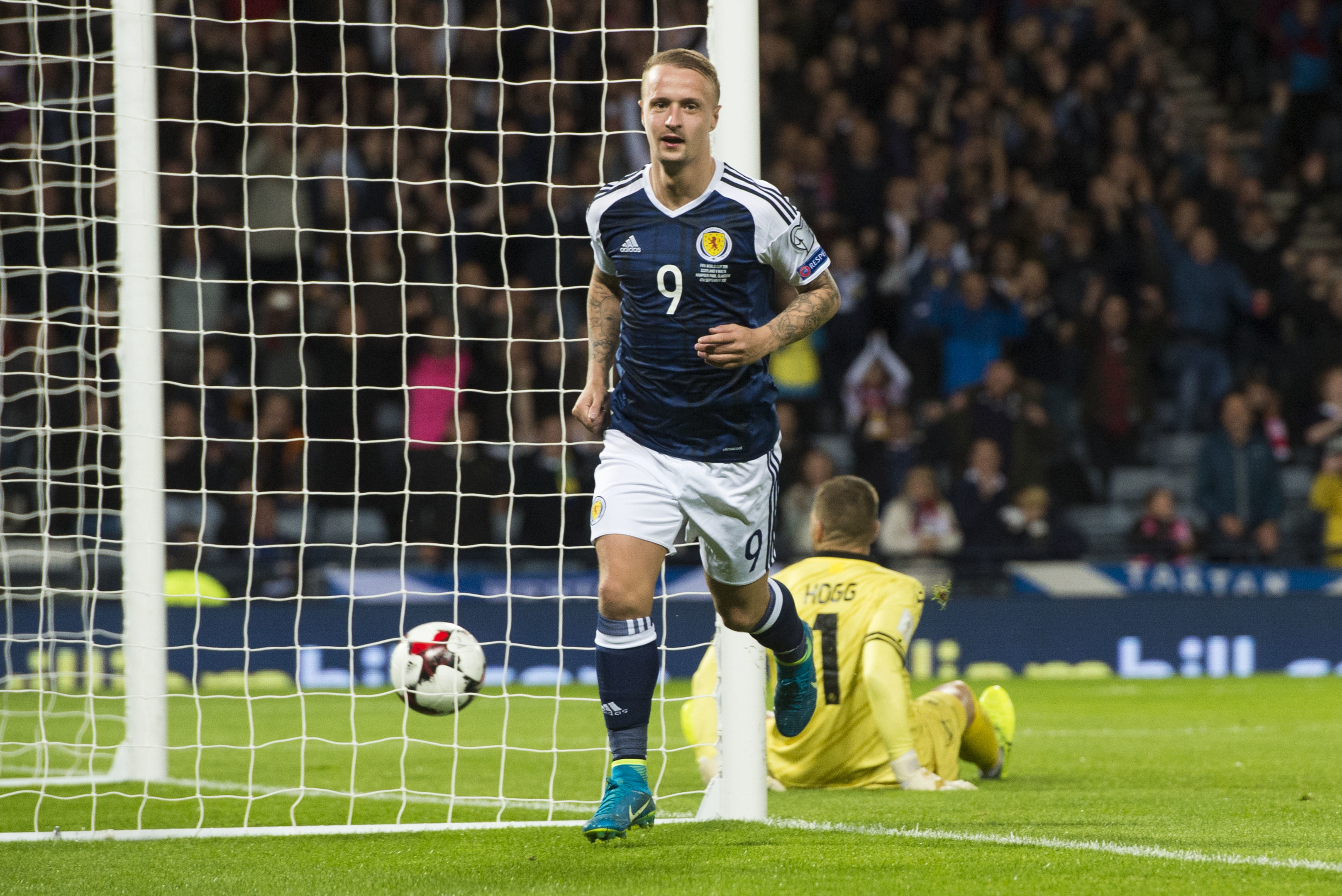Scotland's Leigh Griffiths celebrates after scoring his side's second goal.