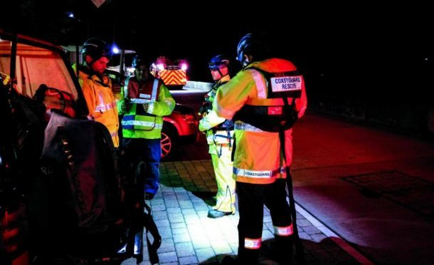The coastguard team during last night's rescue. Picture from HM Coastguard Angus & Mearns