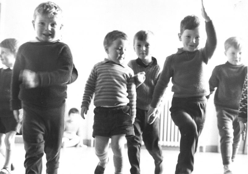 1968: Marching during a music and movement period at Mastrick Community Centre nursery.