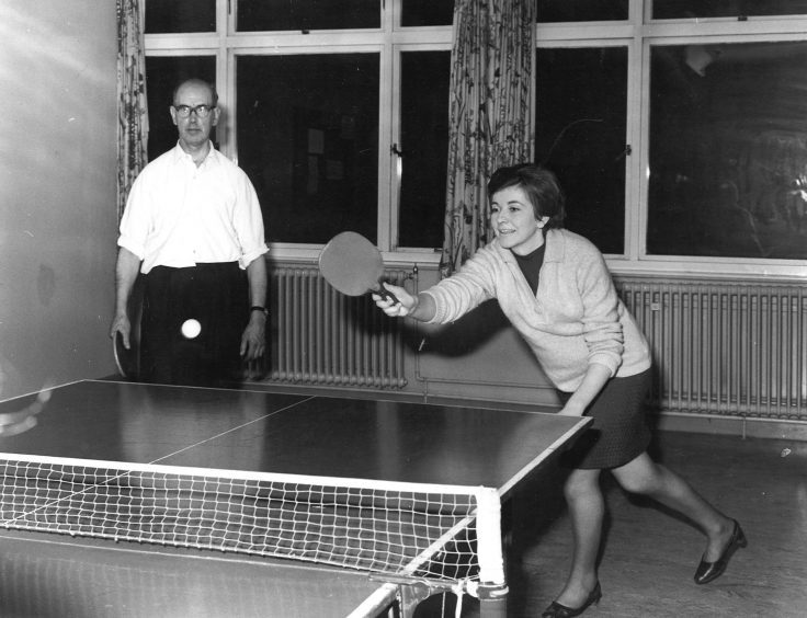 1968: Kathleen Mair makes a fine return watched by Alex Park during a table tennis match.
