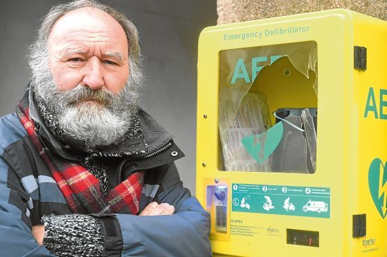 Pictured is Phil Mills-Bishop Chairman of Stonehaven Comunity Council pictured with the vandalised defibrillator box  which is located in Stonehaven Market Square. Picture by Chris Sumner Taken 1/10/17