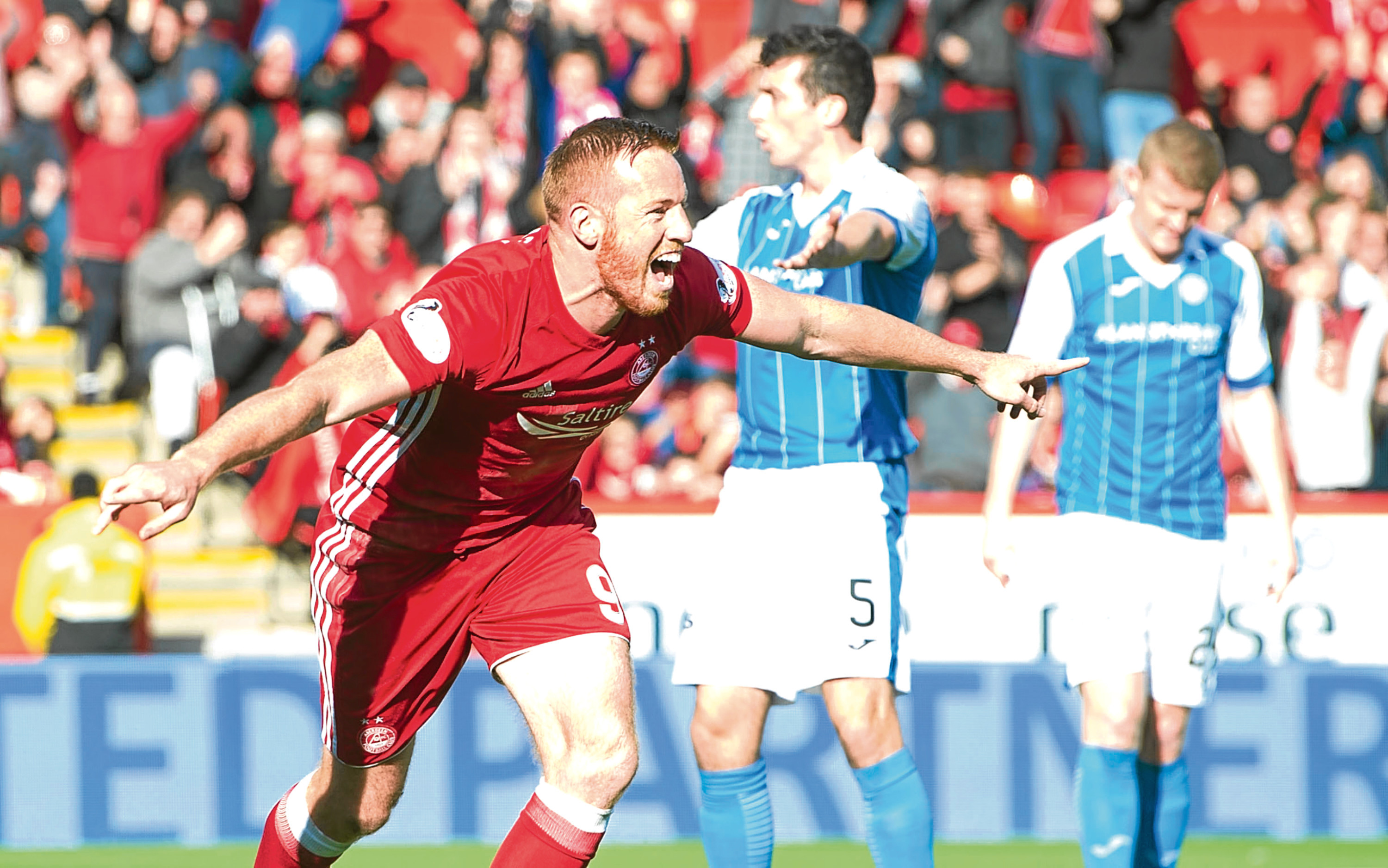 Aberdeen's Adam Rooney celebrates scoring against St Johnstone.