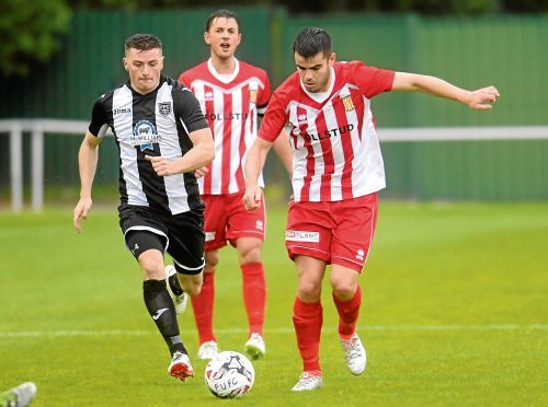 Calum Dingwall in action for Formartine, right.