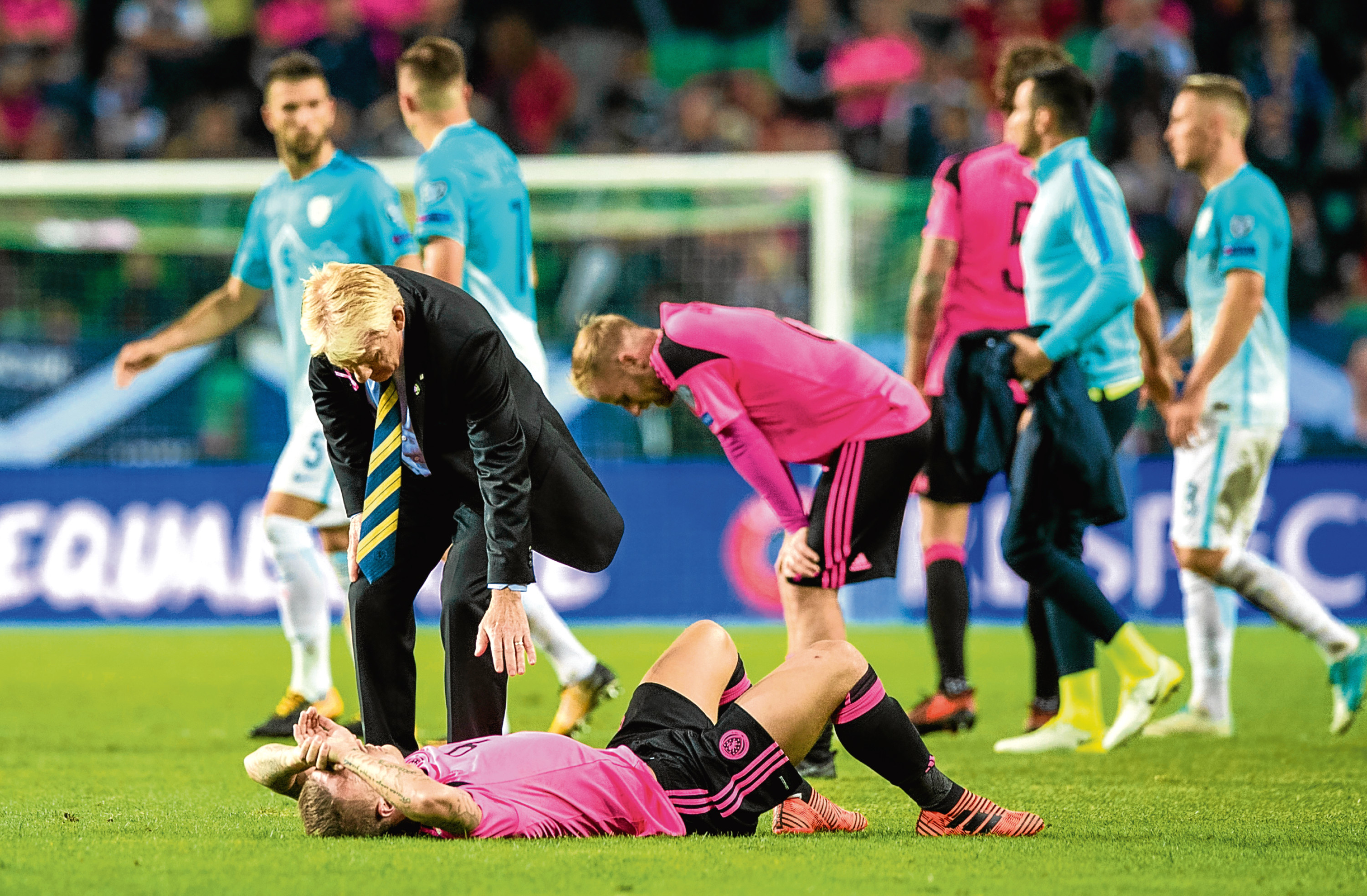 Scotland manager Gordon Strachan with Leigh Griffiths at full-time.
