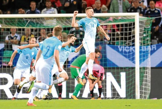 Slovenia's Roman Bezjac celebrates scoring his side's second goal of the game during the 2018 FIFA World Cup Qualifying Group F match at Stadion Stozice, Ljubljana. PRESS ASSOCIATION Photo. Picture date: Sunday October 8, 2017. See PA story SOCCER Scotland. Photo credit should read: Adam Davy/PA Wire. RESTRICTIONS: Use subject to restrictions. Editorial use only. Commercial use only with prior written consent of the Scottish FA