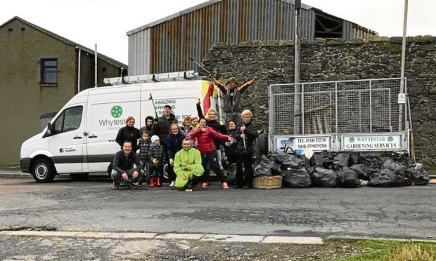 Fraserburgh litter pick at Four Corners. and its a group organised by a Fraserburgh gym owner called Milena Tkacz.  She owns the PolFit fitness studio on Fraserburghs high street.