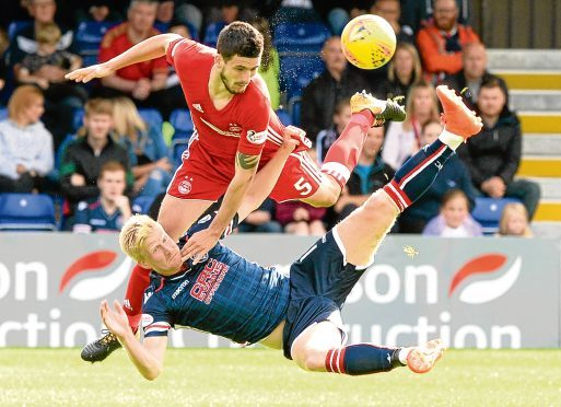 Aberdeen's Anthony O'Connor battles with Ross County's Thomas Mikkelsen.