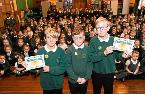 Pictured are Fernielea School pupils from left, Bradley Chalmers, 11, Tyler Hood, 10 and Jac Banks, 11 in front of their whole school at a special assembly.