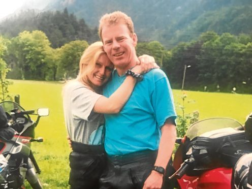 Policeman John Alcock has died after being in a coma for 14 years following a car crash.  Pictured is John and Donna Alcock.