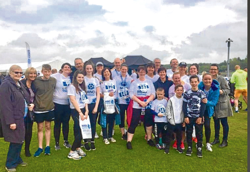 Graeme with family and friends who took part in the MND Scotland Fun Run to raise funds for research into the condition.