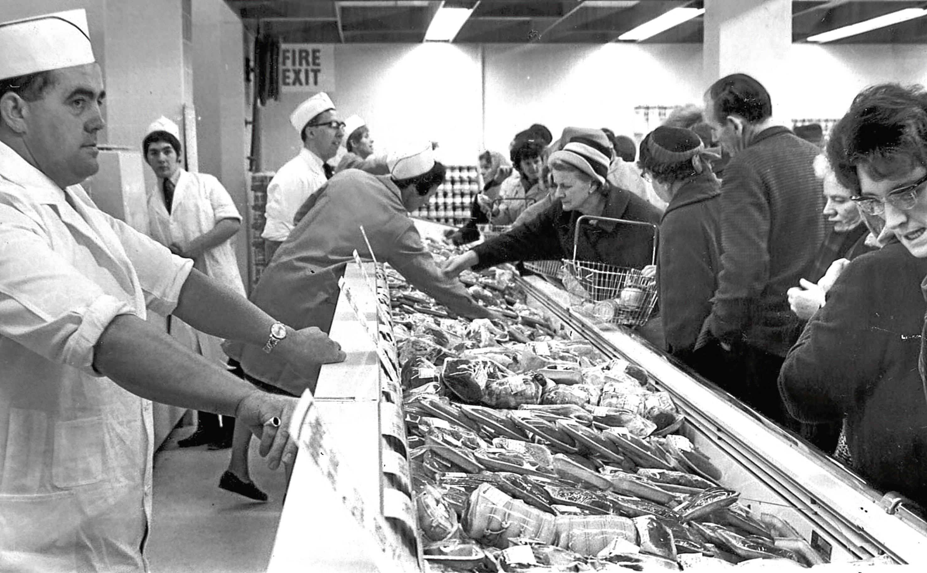 Shoppers in Grandfare's fresh meat section on the day it opened.
