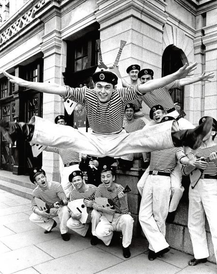 1989: Igor Zhuk gets off to a flying start with the cast from the Red Navy outside His Majesty's Theatre.