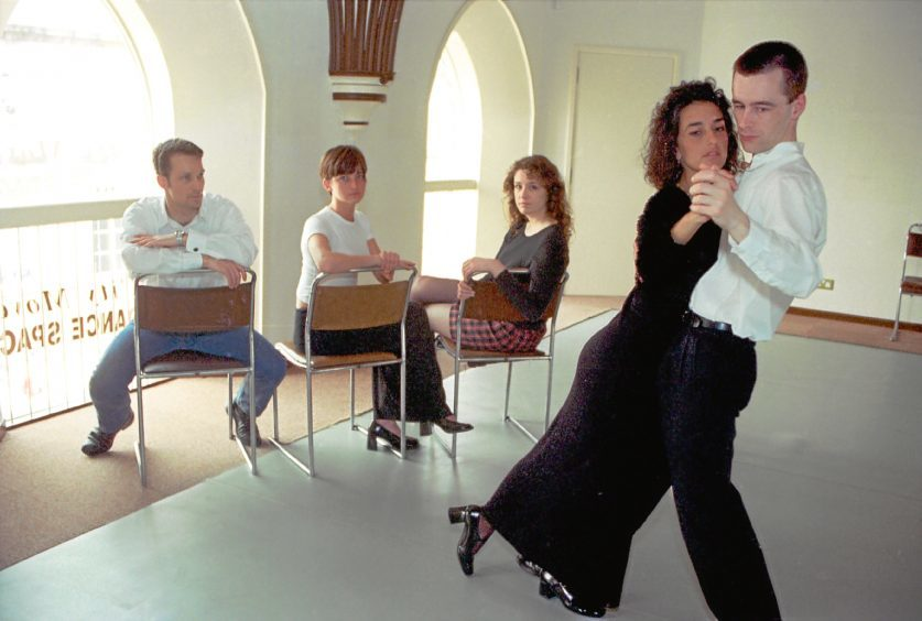 1997: Yolanda Lacoma and Peter Leil, watched by dancers who lost out on tuition when Latin American champions Eduardo and Alison Del Rio's flight was cancelled.