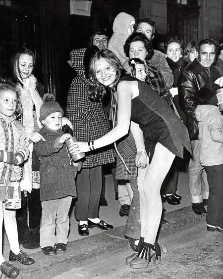 """Aberdeen Students' Charities - Torcher Parade 1973-04-28 (C)AJL Neg.No. 73-2376 - Scanned from print. Used P&J 30.04.1973 """"Pretty Lind Harper had little difficulty in persuading this wee chap in parting with a coin during the Aberdeen student' Torcher [parade] through the streets of Aberdeen on Saturday night."""""""