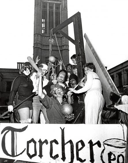 1977: Students get into the swing of it on board a float as it passes by Greyfriars Church.