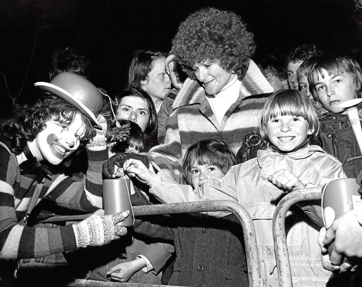 1979: Edna Williamson, left, collects pennies from some youngsters as the fun continues throughout the parade.