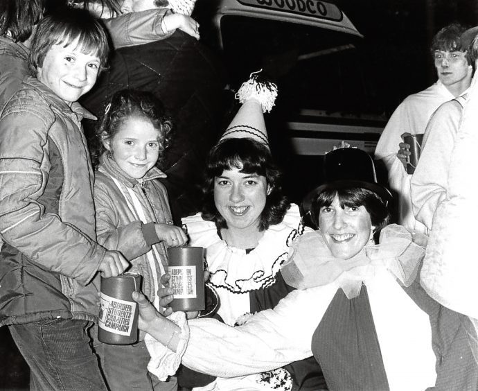 1982: Keith Webster, 9, and sister Diane, 7, hand over money to Ruth Gibb, centre, and Caroline Thomson.