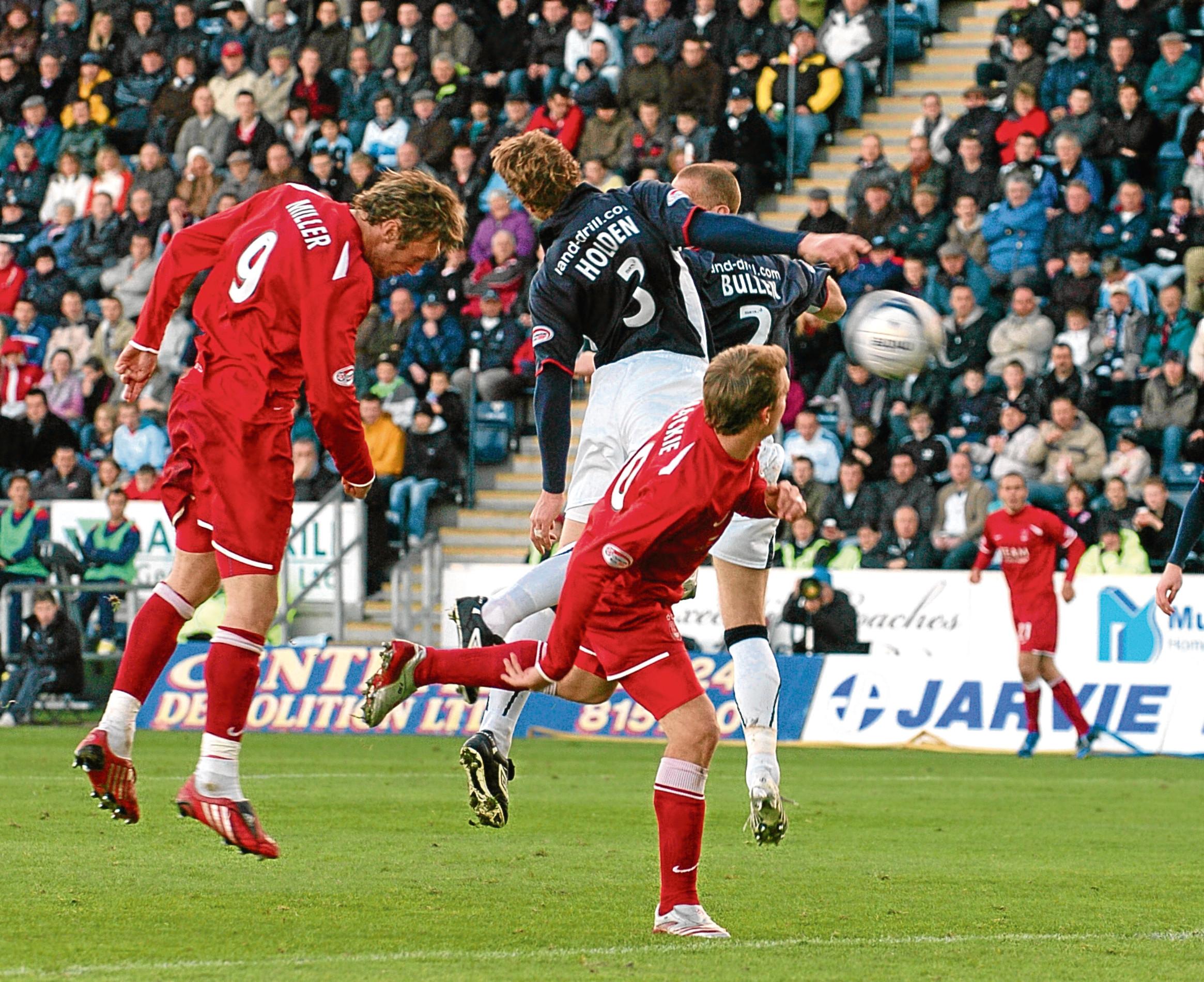 Lee Miller scores his goal during  the match at Falkirk Stadium, Falkirk.