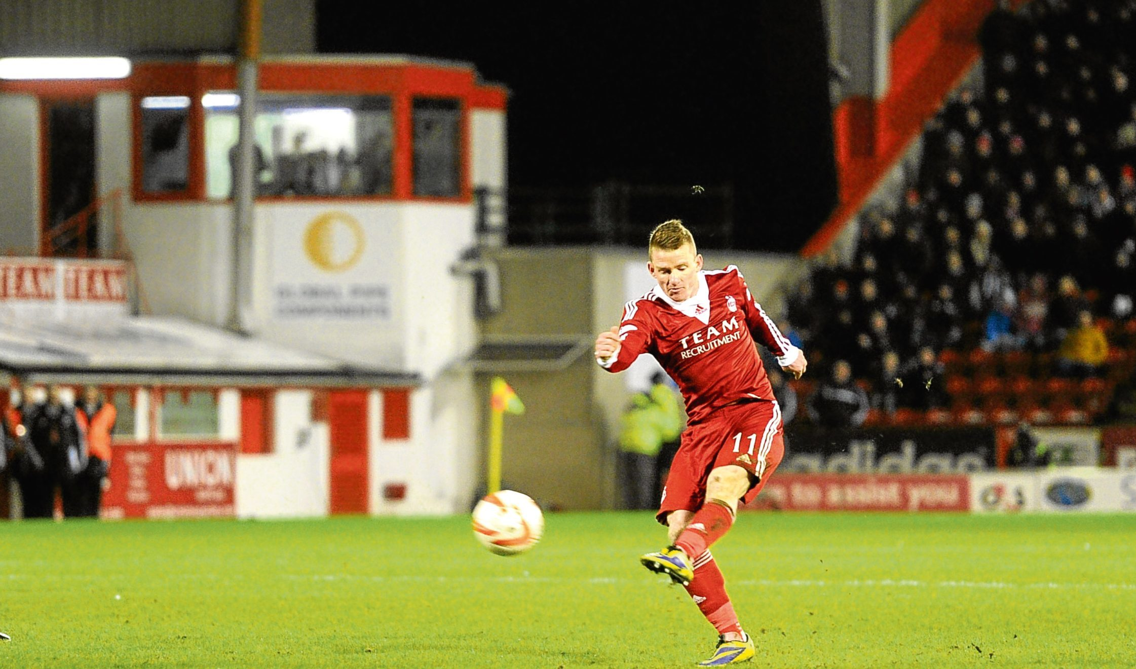 Dons winger Jonny Hayes scores for Aberdeen against Celtic at Pittodrie.