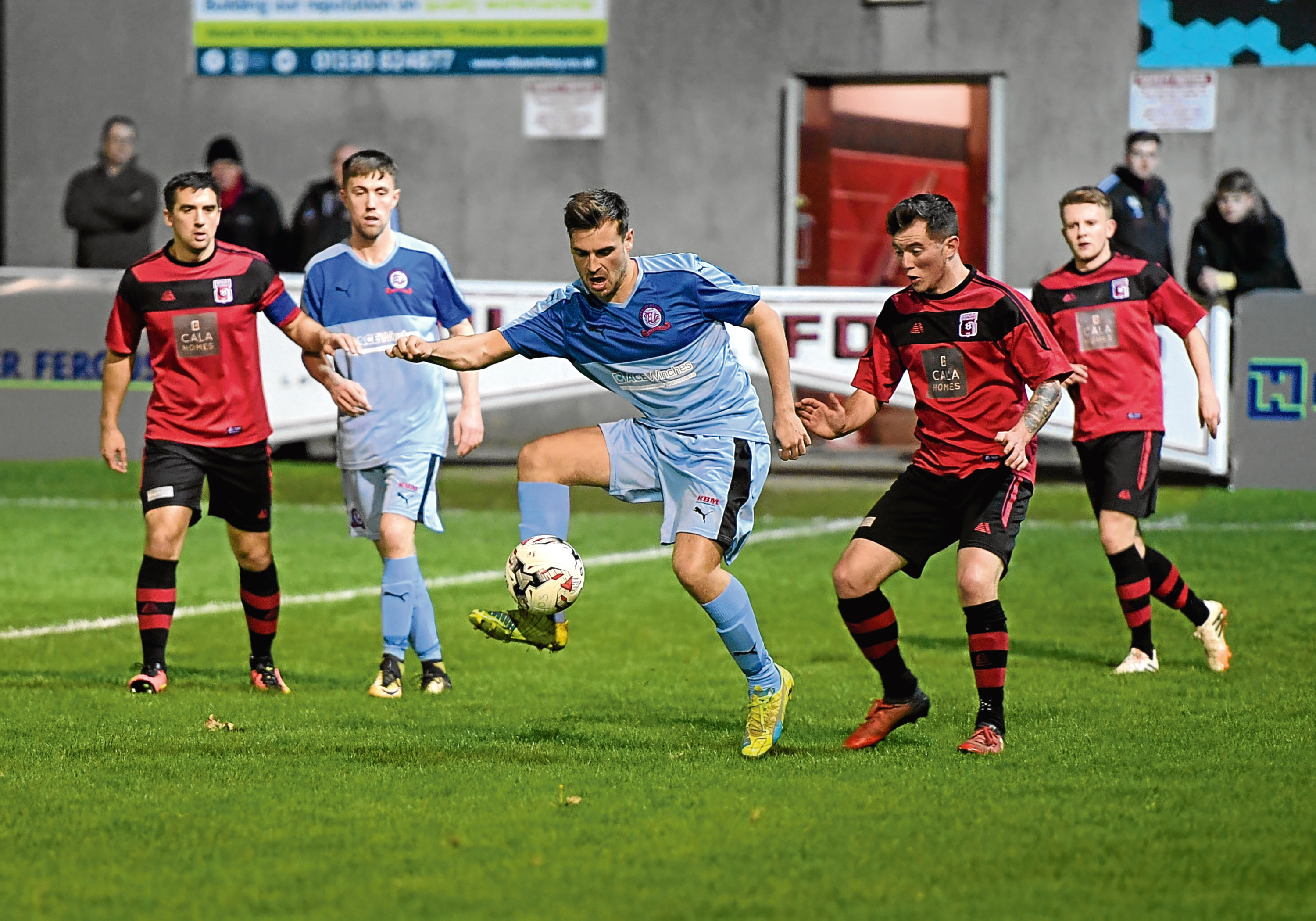 Turriff's David Ross on the ball against Inverurie Locos.