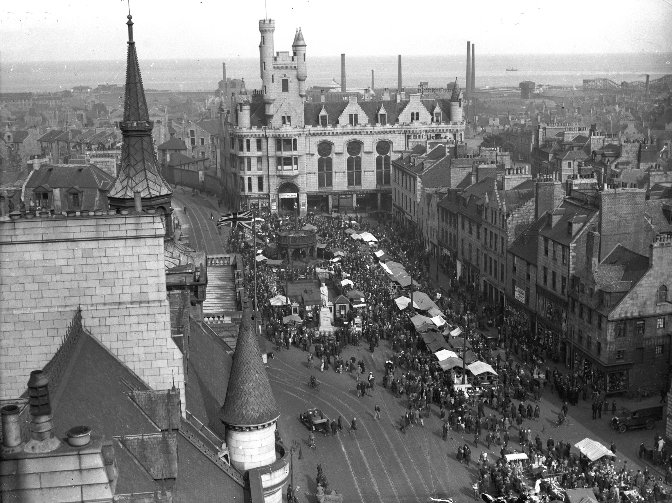 Hundreds of North-east folk flocked to the Timmer Market in Aberdeen's Castlegate in August 1934. The Timmer Market had been held annually in Aberdeen for one day in August since before 1773. Until 1934 it was set up in the Castlegate, but from 1935 was held on the market stance off Justice Street.