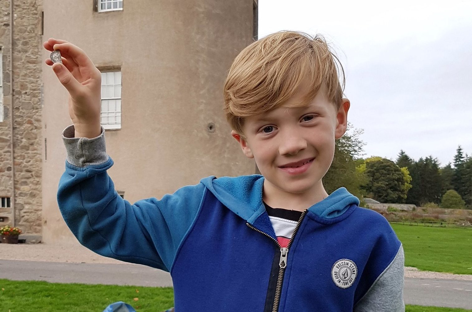Sonny Crighton with the half sixpence found at Castle Fraser