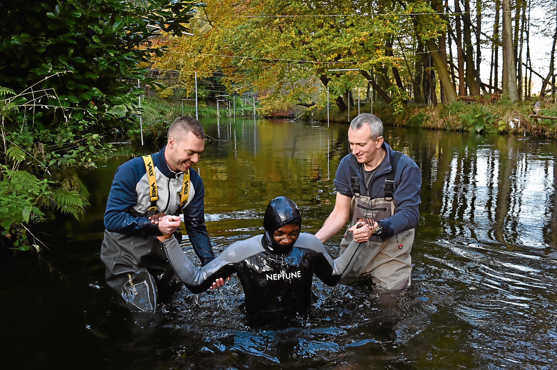 The Mission Church held a baptism for Simisola Otukoya in the River Ron. Steven Hamilton, Simisola Otukoya and Andrew Hamilton during the baptism.