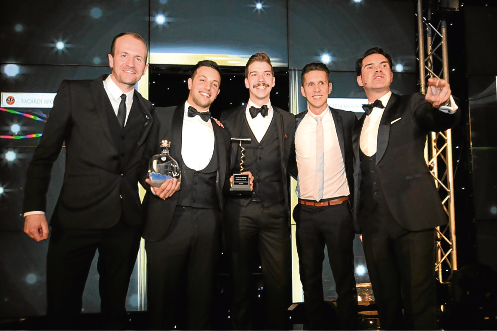 The Orchid Bar team including general manager Nick Gordon, centre, with Jimmy Carr, far right, at the SLTN awards.