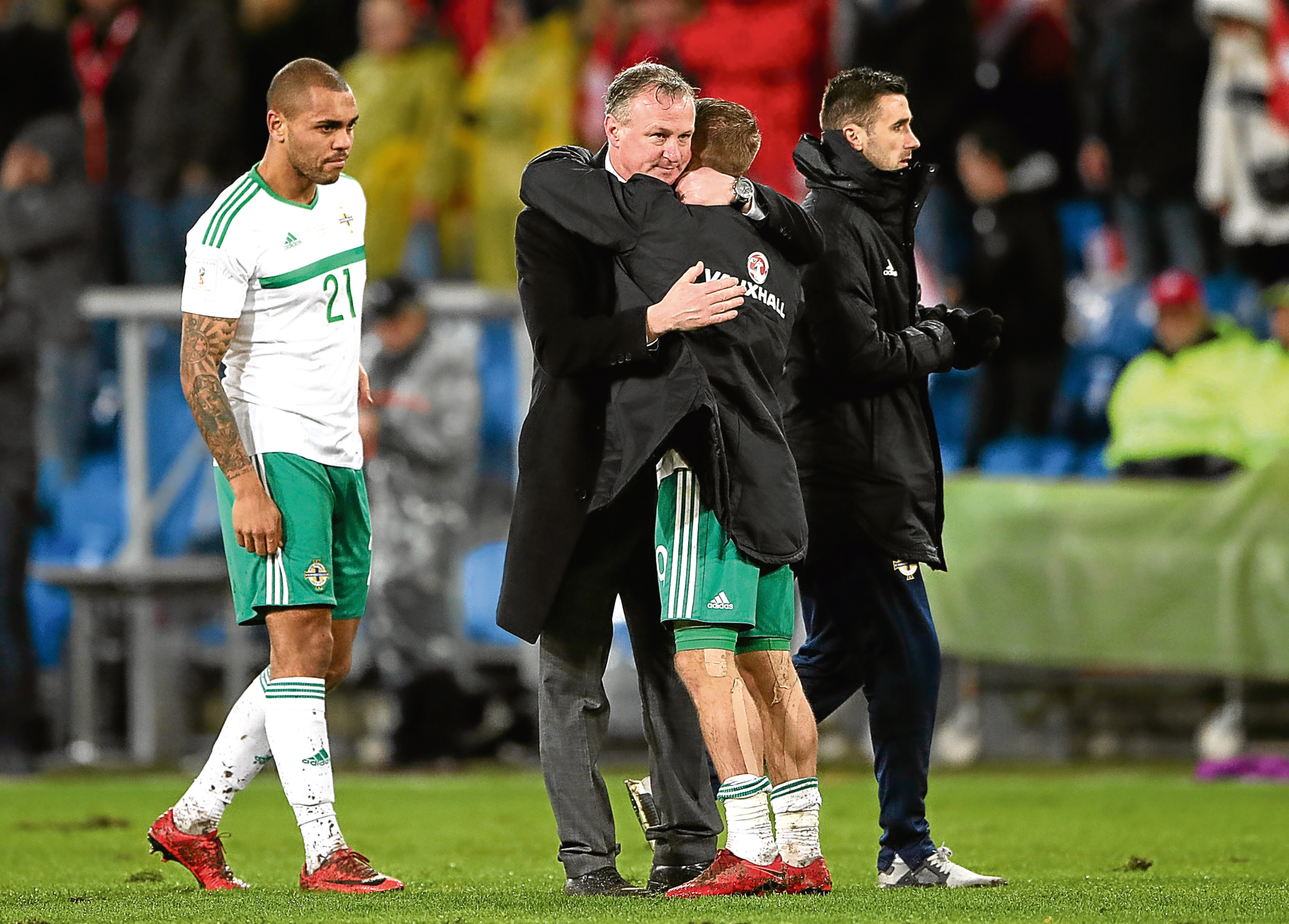 Michael O'Neill, centre, holds Kennedy's international fate in his hands.
