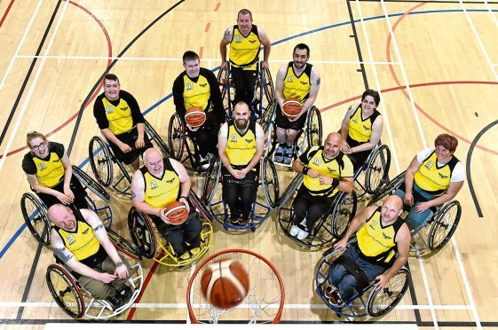 Grampian Flyers wheelchair basketball team.Pictured are (front L-R) Kevin Duguid, Tony Stott, Grant Wilson, Neil Duncan, Richard Craig. (back L-R) Rachel Gilbert, Jay Moir, Euan Thoirs, Wayne Pirie, Auston Mckenzie, Sarah Howken, Emma Cooke.