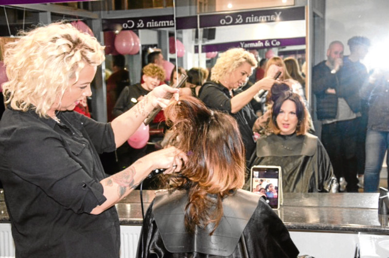 Lynne Thompson-Howell gets her hair shaved