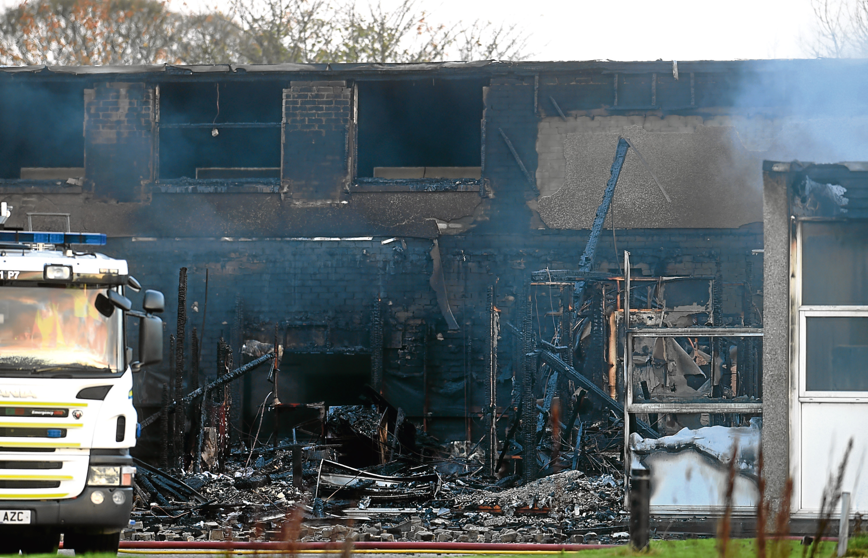Firefighters at the scene of the fire at Cordyce School