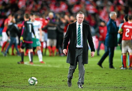 Michael O'Neill looks dejected following the FIFA 2018 World Cup Qualifier Play-Off: Second Leg between Switzerland and Northern Ireland at St. Jakob-Park.