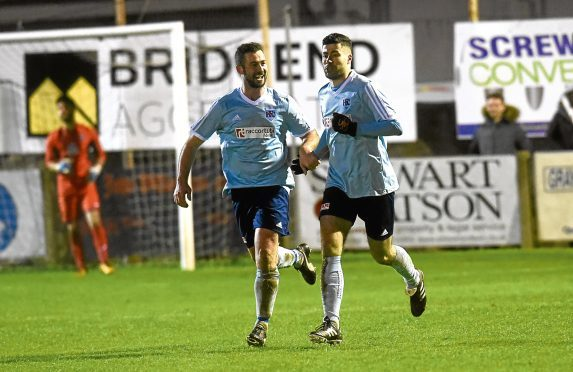Cammy Keith, right, celebrates. Picture by Heather Fowlie