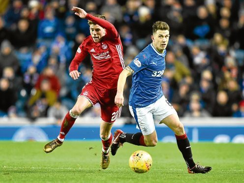 Aberdeen's Ryan Christie and Rangers' Ryan Jack in action.