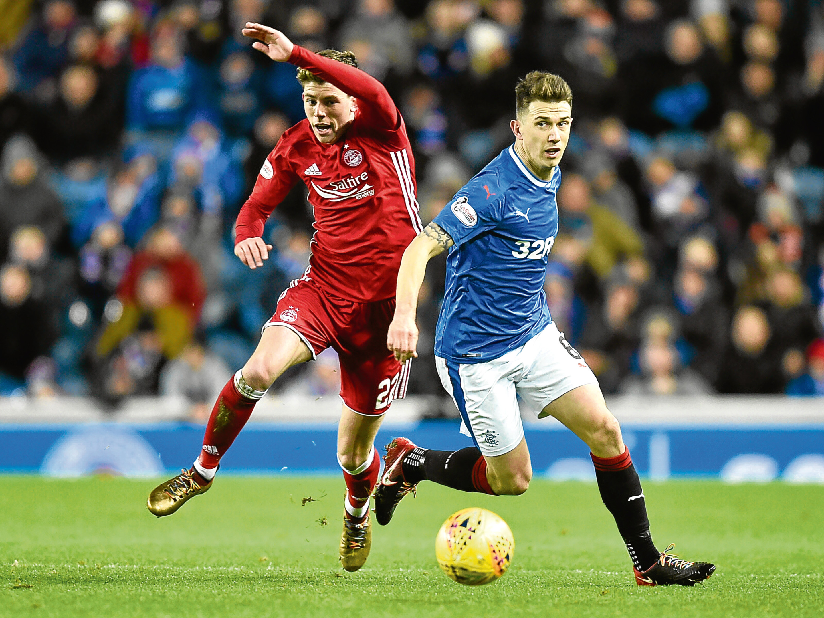 Aberdeen's Ryan Christie and Rangers' Ryan Jack in action.
