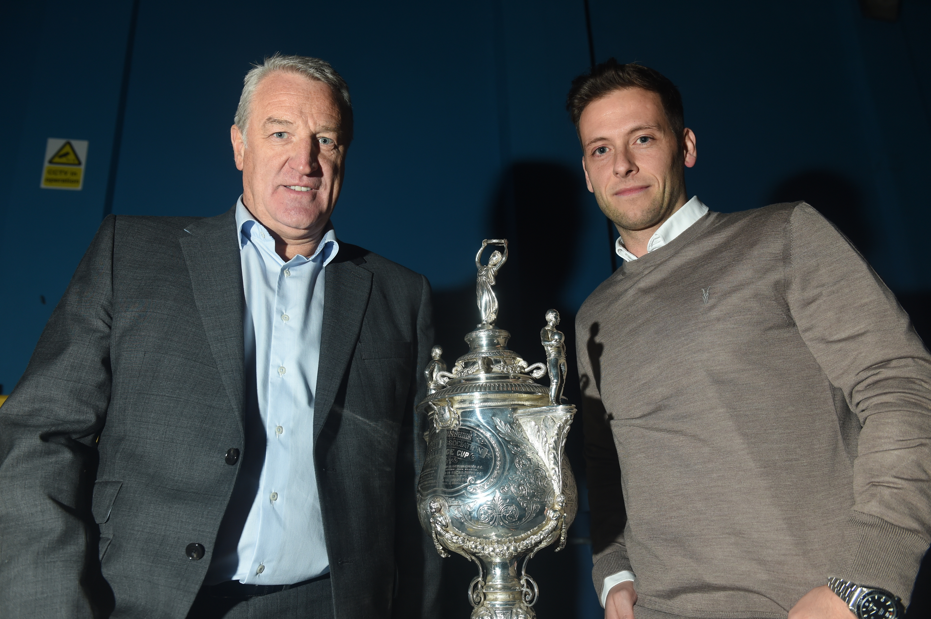John Sheran, left, and Paul Lawson with the cup.