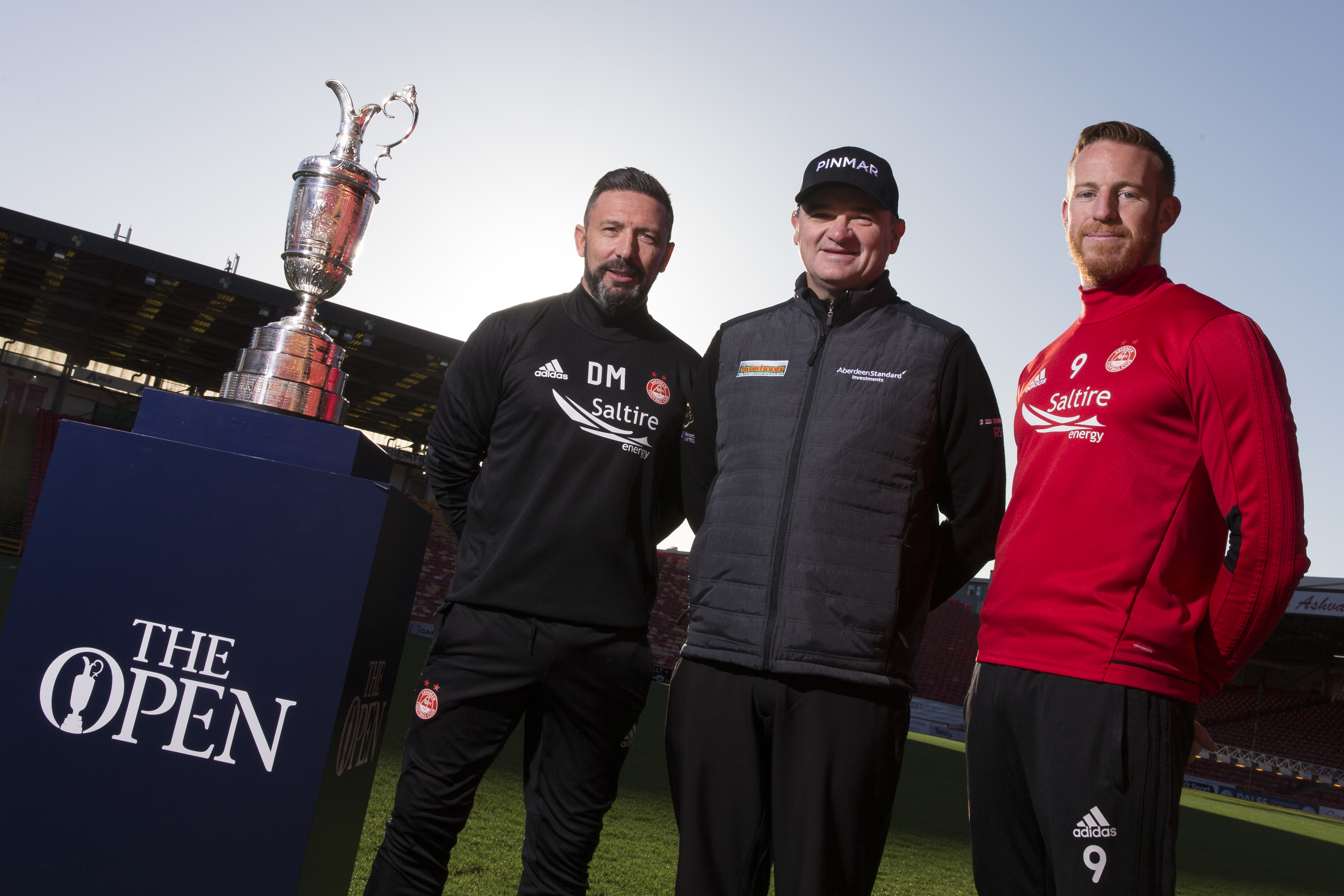 Left to right, Derek McInnes, Paul Lawrie and Adam Rooney with the Claret Jug at Pittodrie earlier this year