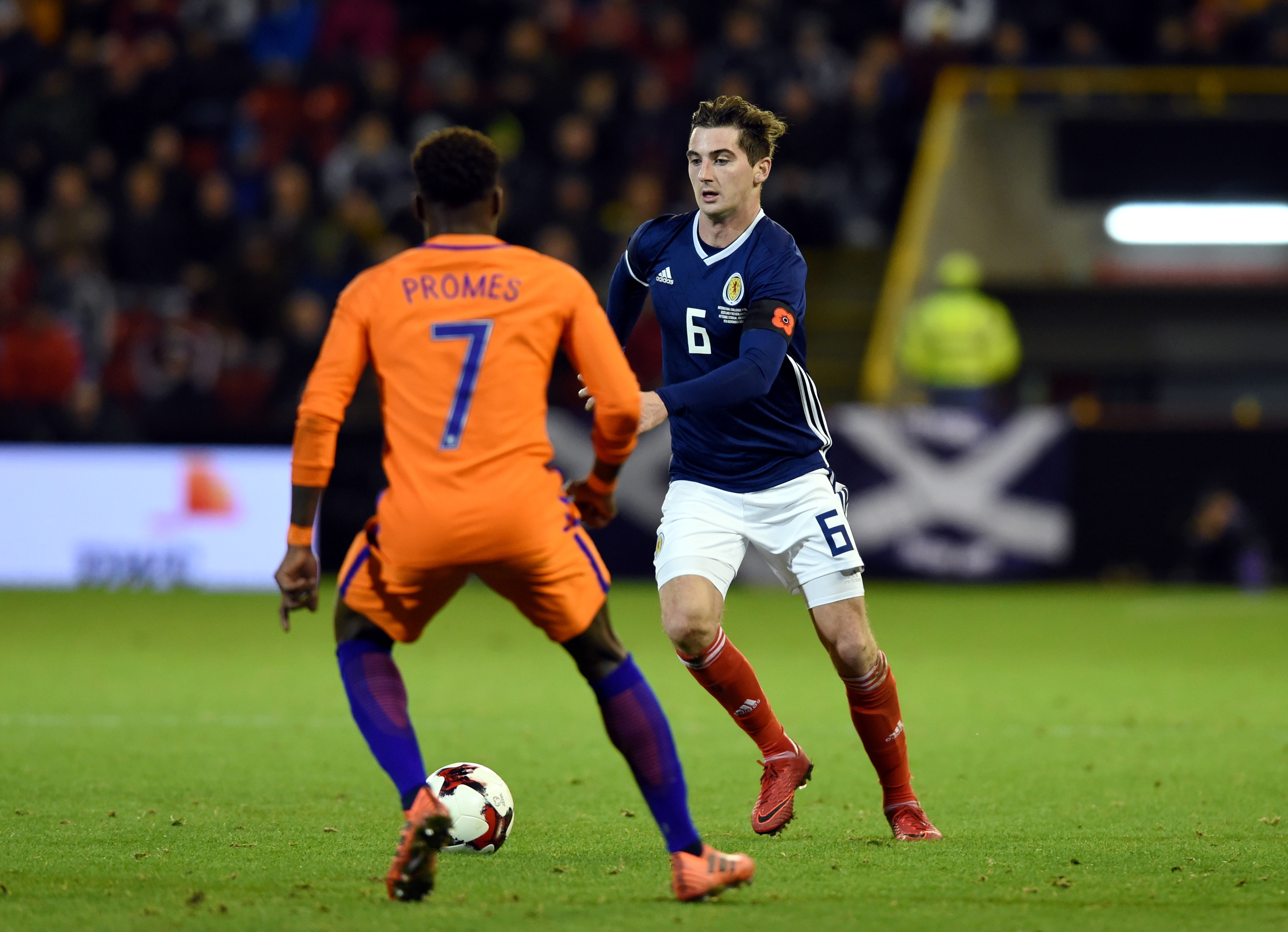 Pictured are Scotland's Kenny McLean and Holland's Quincy Promes. Picture by DARRELL BENNS