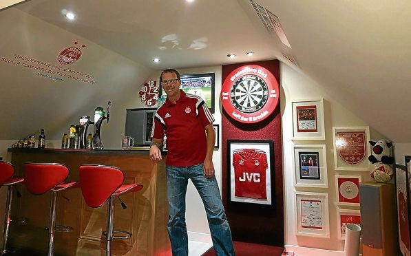 Graeme Strachan in his games room.