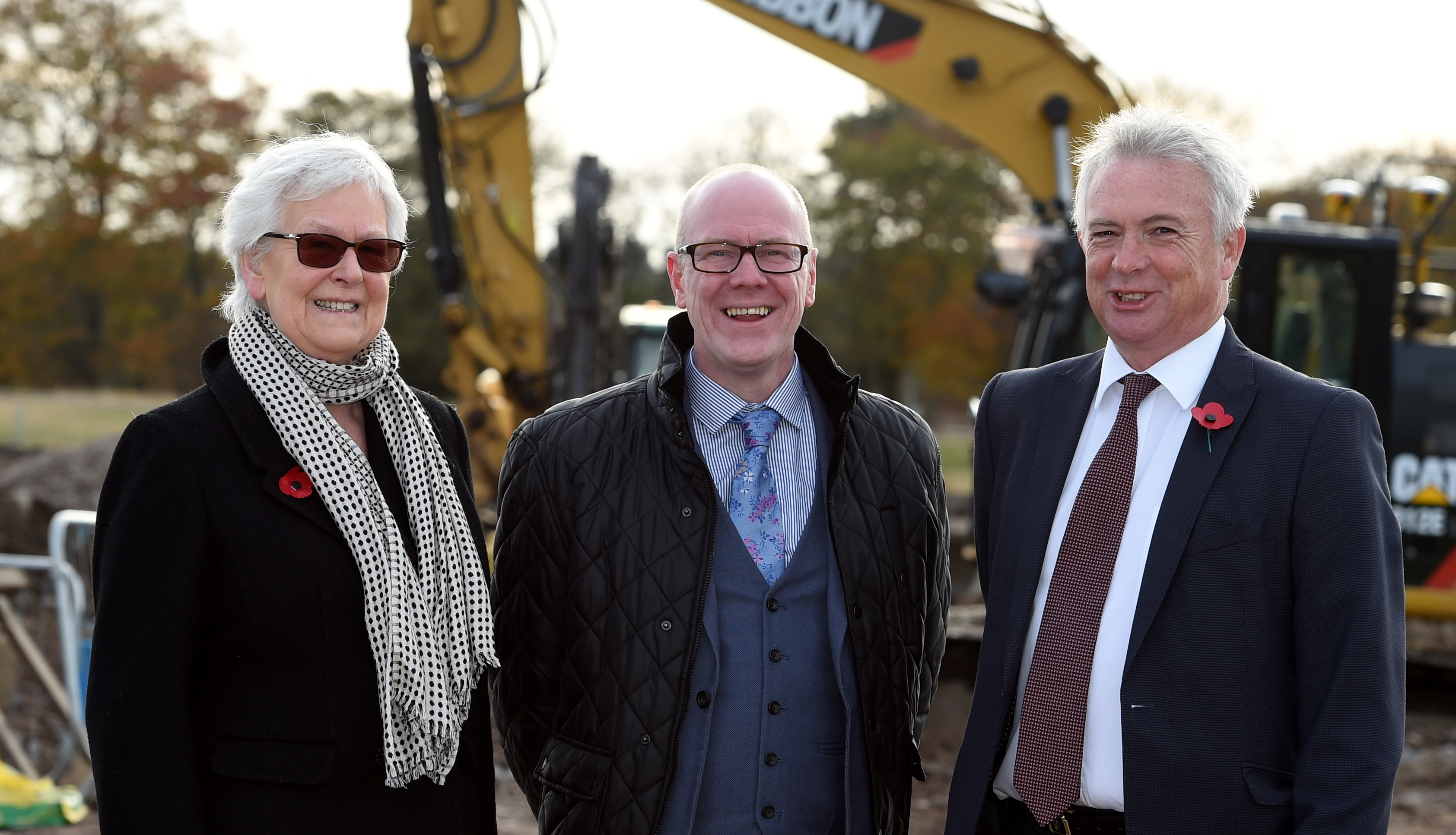 Val Howard, chairwoman of Hillcrest, Kevin Stewart, Housing Minister and Glenn Allison, CEO of Stewart Milne and Hillcrest.